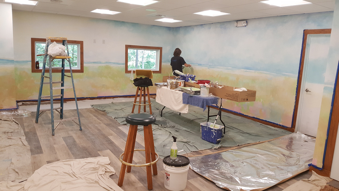 enlightened solutions mural and building interior.Blue Heron Pines golf course Enlightened Solutions
